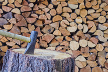 ax in a stump and firewood