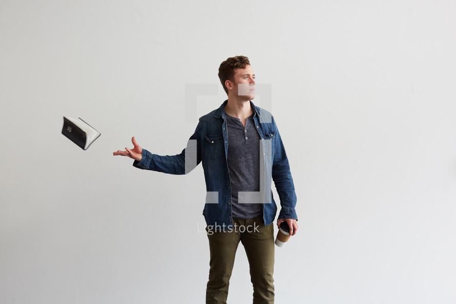 a man tossing a Bible away