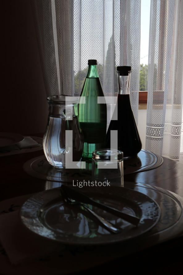 pitcher of water by a bedside