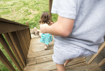 children walking down deck stairs