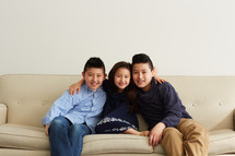 siblings on a couch