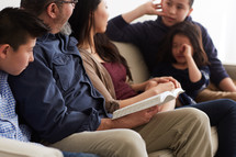 quality family time reading a Bible