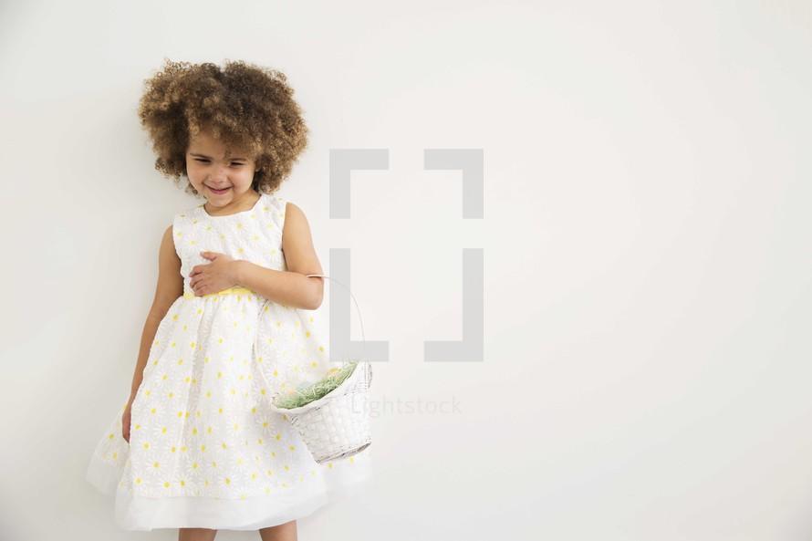 girl child holding an Easter basket
