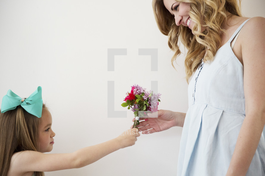 daughter giving mom flowers.