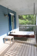swinging day bed on a porch