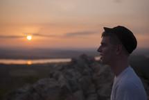 man watching the sun set