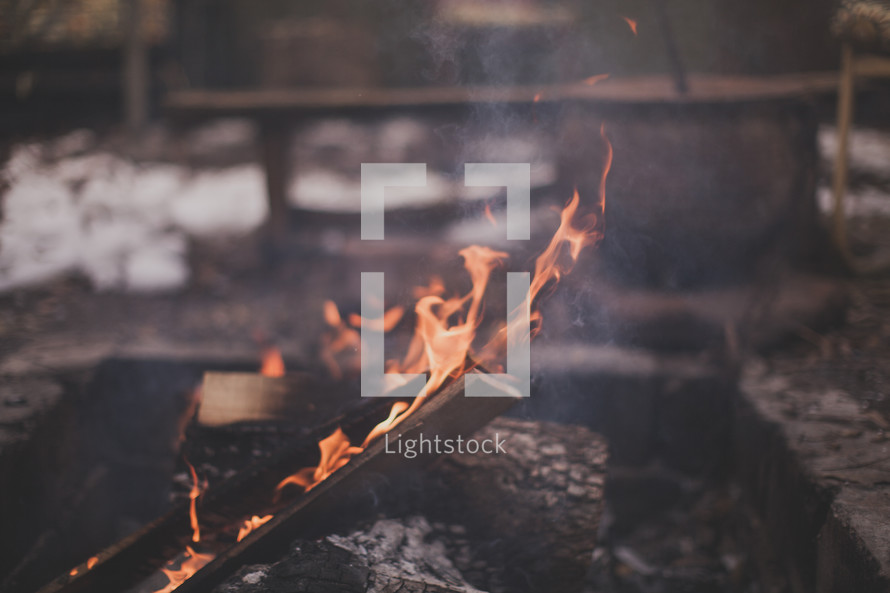A fire burning in a fire pit