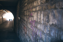 brick wall in a dark tunnel