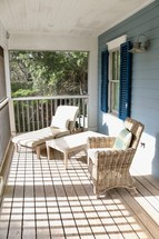 wicker furniture on a porch