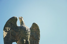 top of a flag - Statute of eagle with wings spread