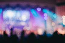 blurry image of an audience at a concert