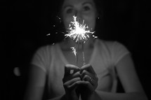 woman holding a sparkler