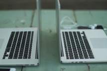 Dueling laptops.