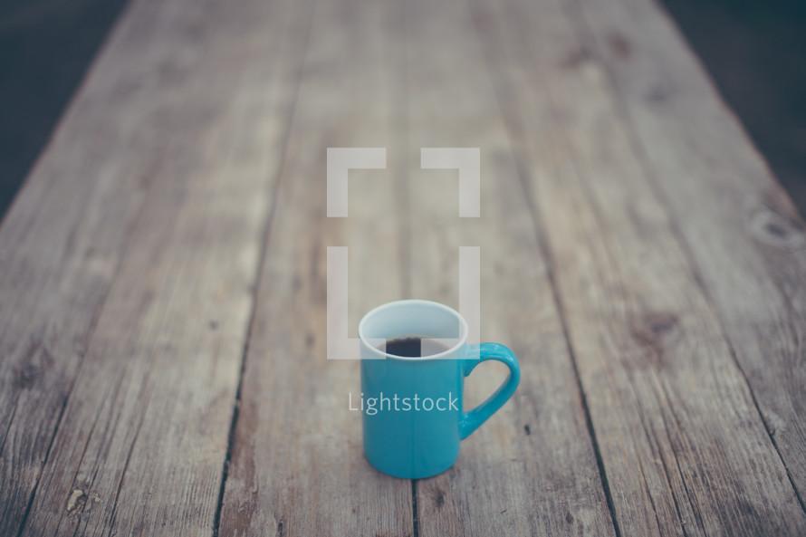 coffee mug and wood table