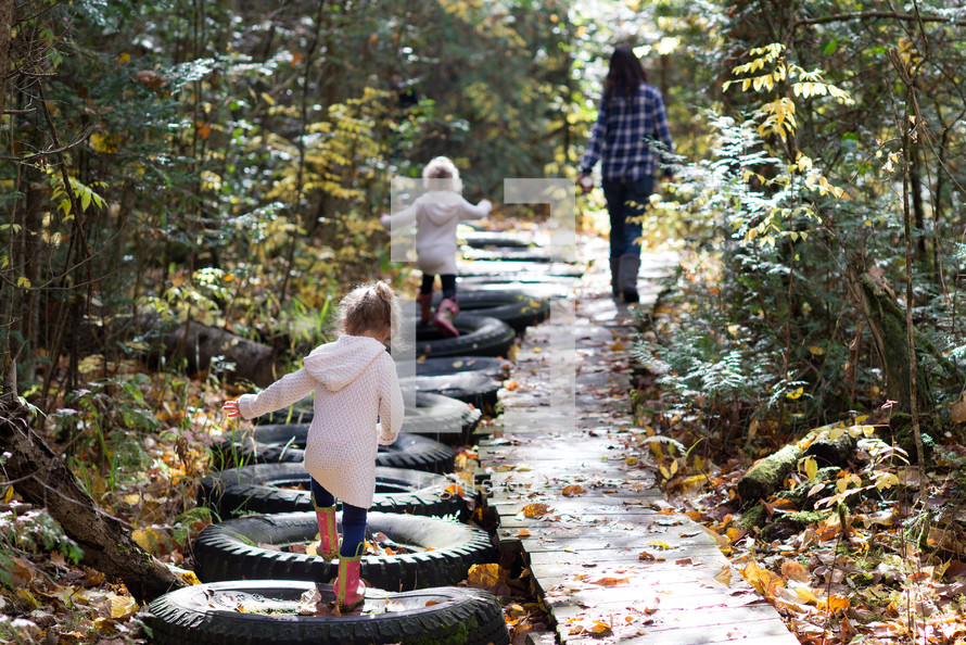family walking on a nature trail