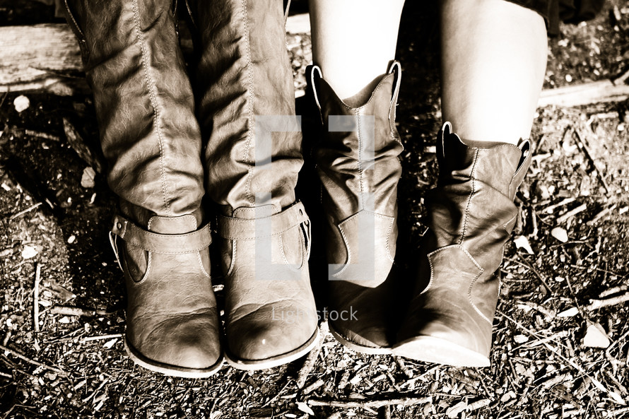 Two western pairs of boots worn by good friends dressed in cowgirl attire.