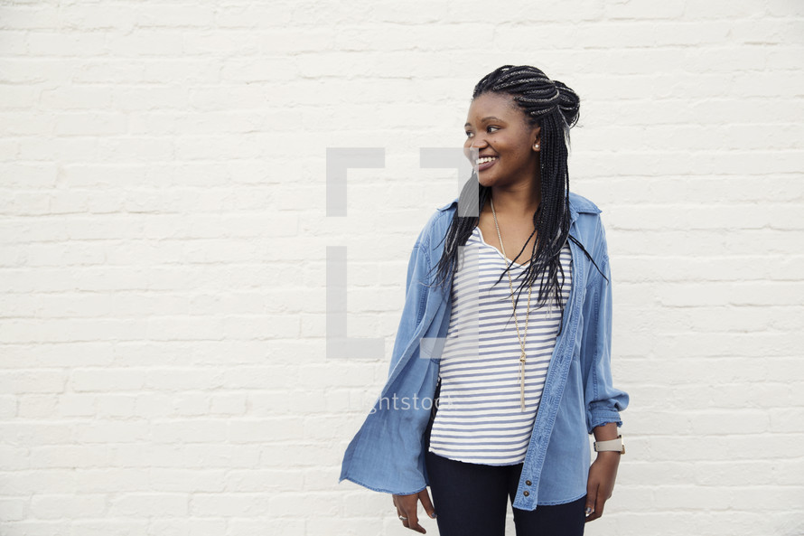A young African American woman standing smiling