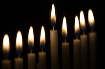 flames on candles against black