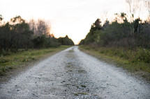 A gravel road in the country.