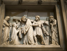 Marble statute if Jesus carrying the cross.