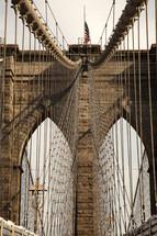 Web of cables suspending a bridge.
