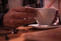 man holding a tea cup