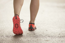 Close up of woman's running shoes as she walks.