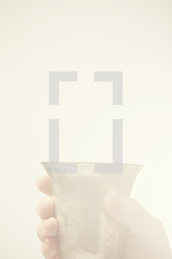 Jesus holding a chalice