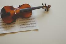 a violin on sheet music