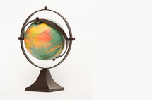 Spinning world globe on a white background
