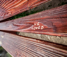 UR loved carved in wood of a bench