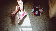 feet in sneakers and magazines