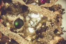 Ornaments on a decorated Christmas tree.