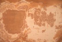 worn red clay wall