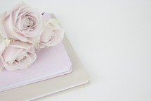 light pink roses on a Bible and journal