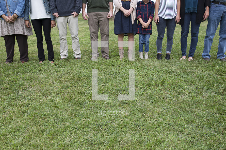legs of family members standing together