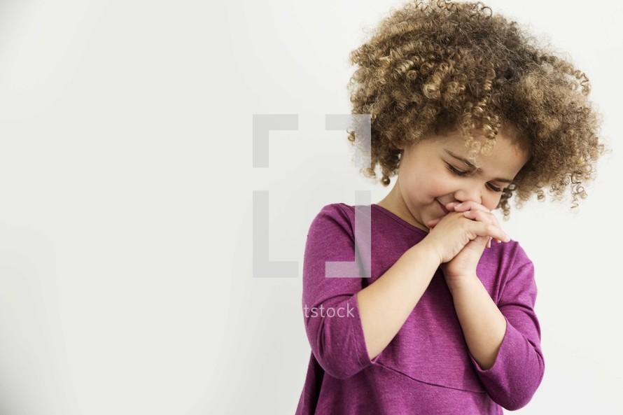 little girl in prayer.