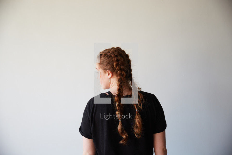 woman with braided pigtails