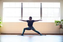 woman stretching in a yoga studio