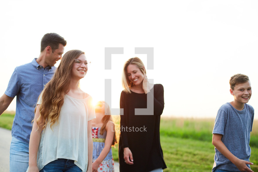 a family walking down a rural road spending time together