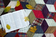 a Bible on a quilt