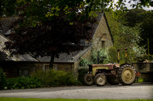 tractor in front of a rural home
