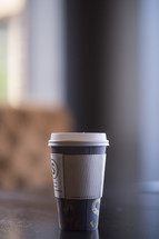 paper coffee cup on a table