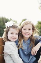 sisters hugging outdoors
