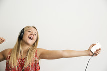 teen girl dancing and singing to music.