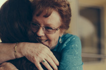 a tender hug between two women