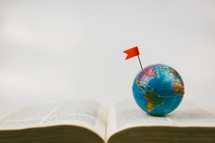 globe and Bible pages