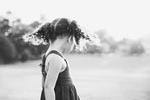 toddler girl standing outdoors