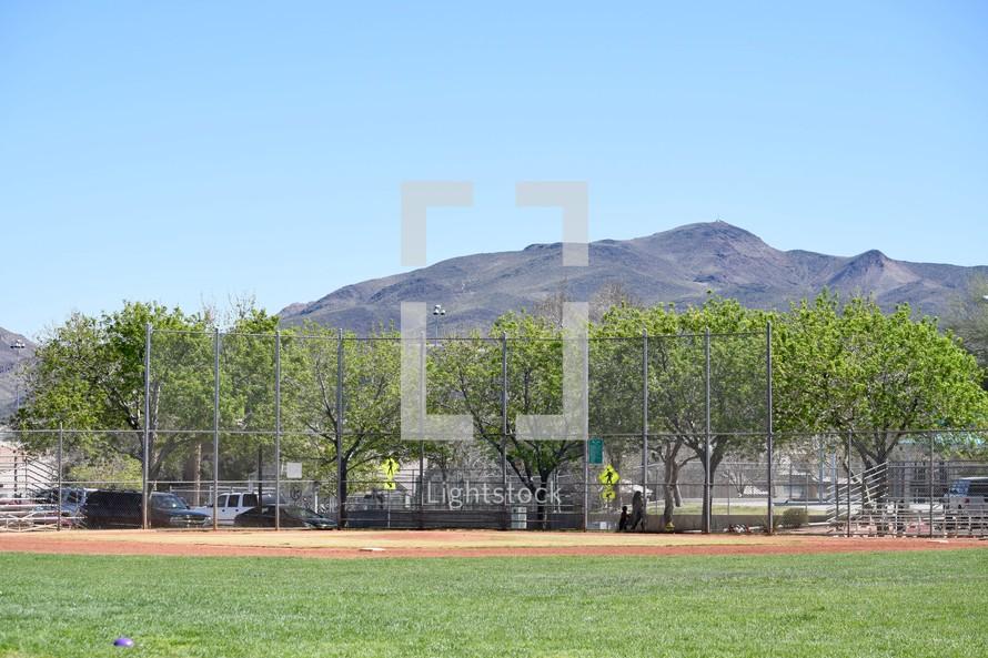 mountain behind a baseball field at a park
