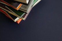 stack of books on a blue background